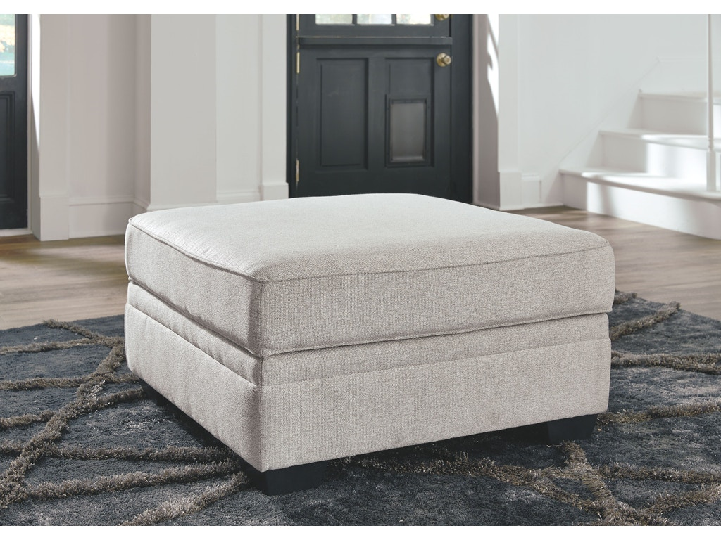 Signature design by ashley living room ottoman with for Signature home designs