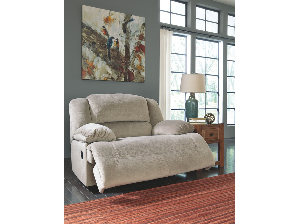 Signature design by ashley living room wide seat recliner for Living room discount furniture