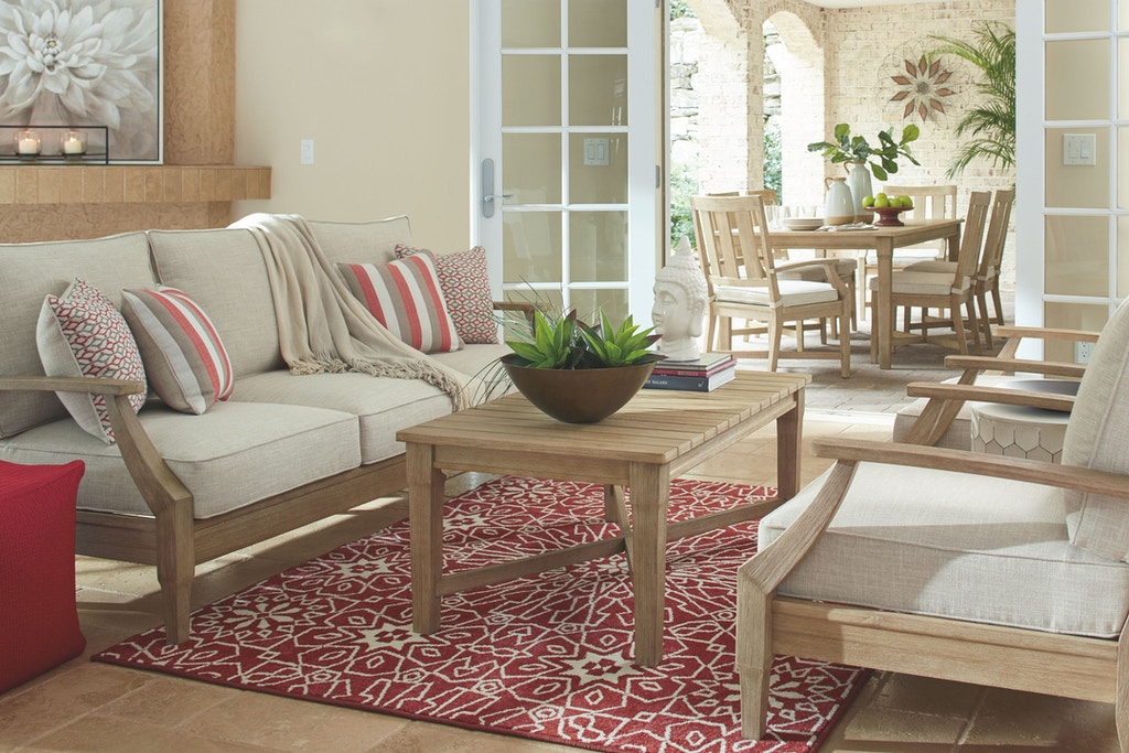 Signature Design by Ashley Clare View Sofa with Cushion ... on Clare View Beige Outdoor Living Room id=44293