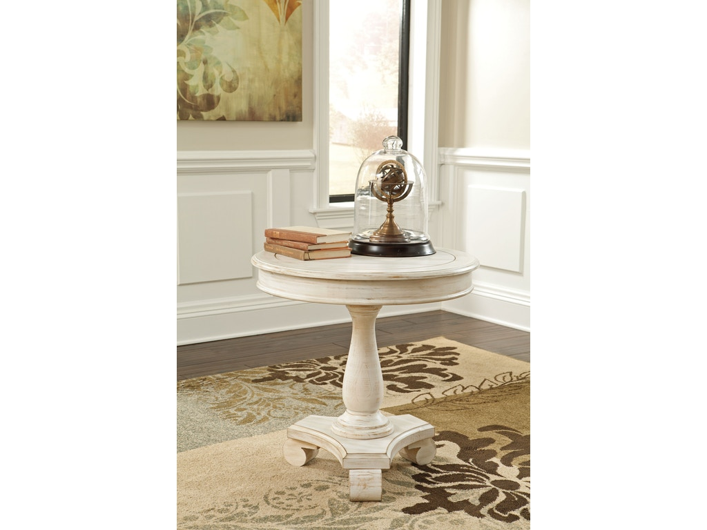 signature design by ashley living room round accent table t505 106 simply discount furniture. Black Bedroom Furniture Sets. Home Design Ideas