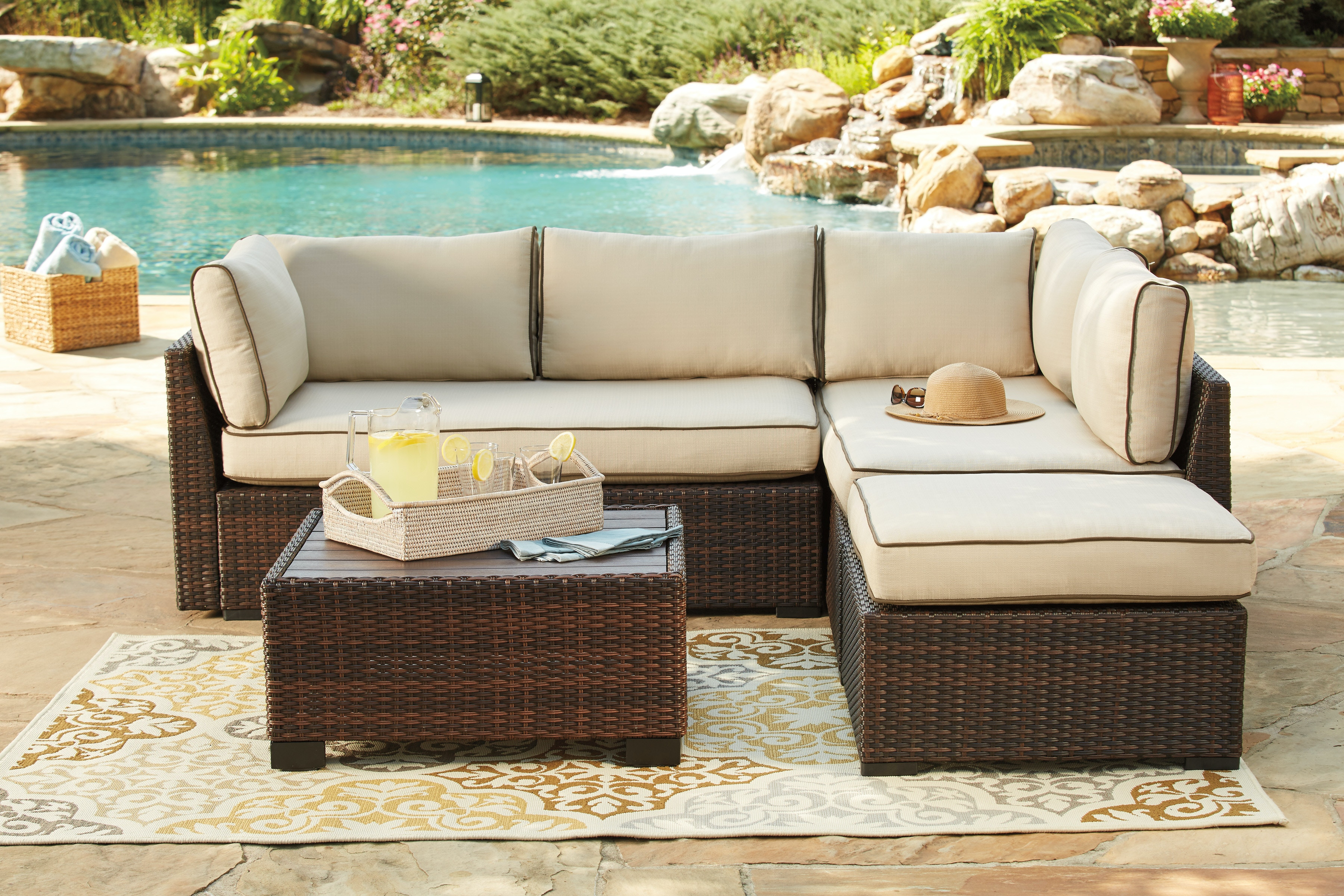 Signature Design By Ashley Loughran Beige And Brown Outdoor Sectional With  Ottoman U0026 Table P300