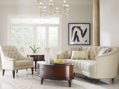 Schnading International This timeless tufted sofa also comes in a chair 9090