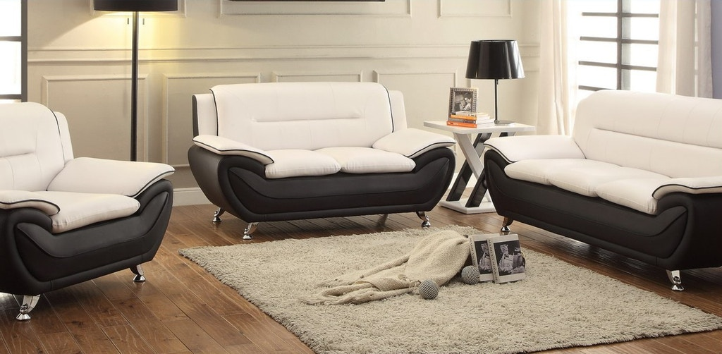 Three piece white/black living room set. Chrome legs.