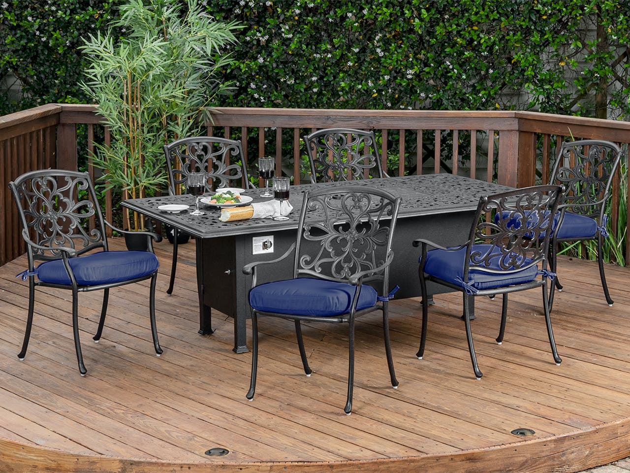 Picture of: Living Room Carlisle Aged Bronze Cast Aluminum 7 Pc Dining Set With 84 X 44 Fire Pit Dining Table