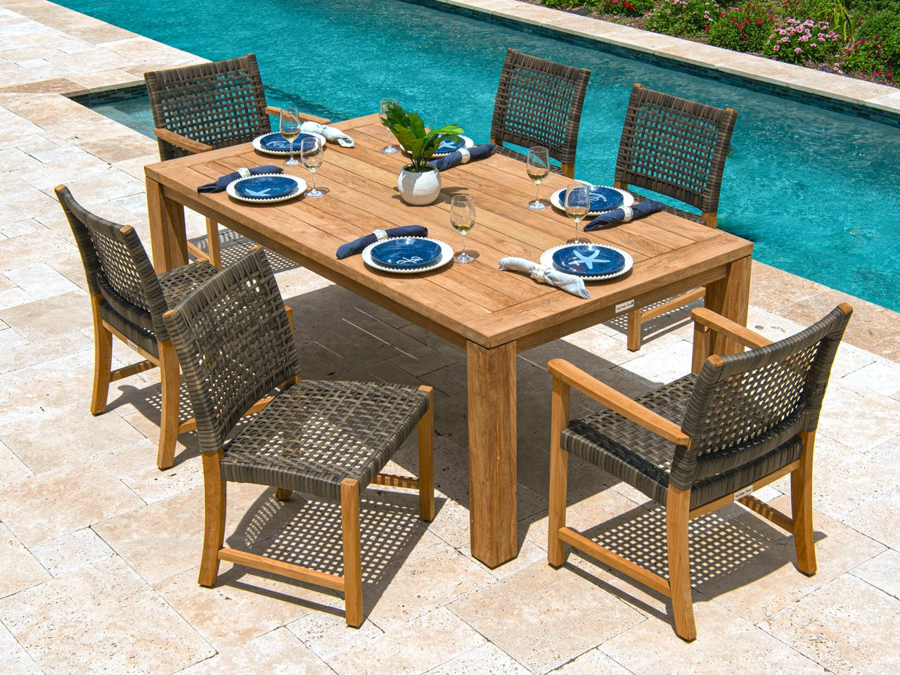 Picture of: Living Room Hampton Driftwood Outdoor Wicker And Solid Teak 7 Pc Dining Set With 79 X 43 In