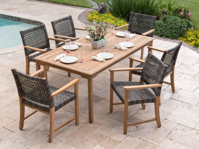 Picture of: Living Room Hampton Outdoor Wicker And Solid Teak 7 Pc Dining Set With 71 X 39 In Teak Table